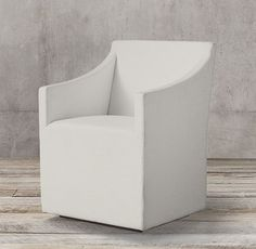 RH's Ellison Slope Arm Fabric Armchair:With restrained lines and slim proportions, our collection exudes timeless simplicity. Amply cushioned for comfort, each chair appears to float on its recessed base.