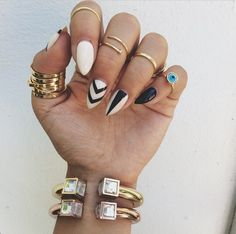 Pointy nails and midi rings