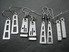 Silver Earrings with saw piercing and oxidised wire detail ...
