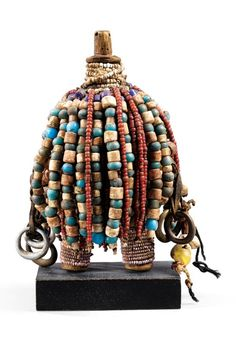 Africa | Dowayo doll from the Dowayo Namji people of North West Cameroon, near the Nigerian border | Wood, textiles, glass beads, cowrie shells, metal | ca. early to mid 1900s | 13,750€ ~ Sold (Sothby's Dec 2008, Paris)