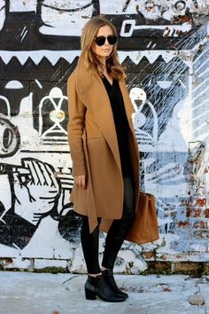 We recommend wearing a camel coat over an all black outfit for the ultimate casual style. Via Amy (curatedbyamy.com). Leggings: Joe Fresh, Boots: Amazon.