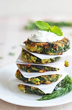 Zucchini, Feta, and Spinach Fritters with Garlic Tzatziki #zucchini #fritters #appetizer