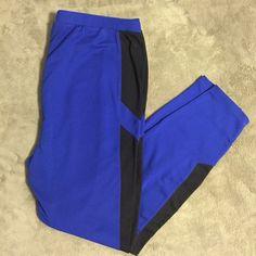 Forever 21 Two-Tone Leggings Vibrant blue and black leggings. Perfect to dress up or down. Nice and thick, so they're great for chilly days. Gently worn, great condition with very little pilling. Forever 21 Pants Leggings
