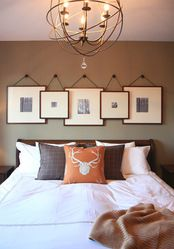 Neat way to hang pictures.  Perfect for our guest room or office