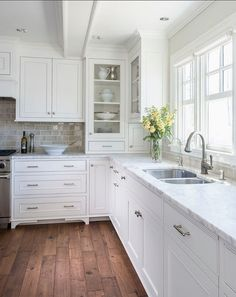 Benjamin Moore Winds Breath OC-24 They are beautifully accented with brushed nickel cabinet pulls alongside calcutta marble counters with a 3″x6″ Encore Silver Ceramic Tile backsplash. The Faucet is the Grohe Bridgeford and the sink is a Kohler Stainless Undertone.