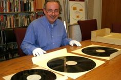 Robert Spindler, archivist and curator for the Arizona Collection at ASU Libraries, displays some recordings former Arizona Gov. Howard Pyle made as a radio broadcaster. In time for Veterans Day, ASU has made available online many of the messages home Pyle recorded for Arizonans serving in World War II. (Cronkite News Service Photo by Corbin Carson)
