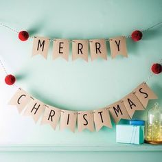 Merry Christmas Bunting With Pom Poms. Discover stylish, personal and wonderfully unique Christmas decorations to turn your home into a festive wonderland.