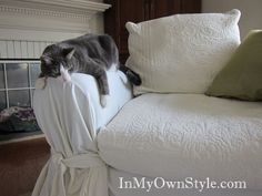How to Cover a Chair or Sofa with a Loose Fit Slipcover - I wonder if I could spruce up my super comfy, but non-modern recliner with the right makeover?