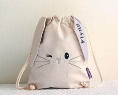 This little bunny bag is very cute and comes with a surprise under one of his ears - his new best friends name! The bag is X and is made using a lovely heavy weight cotton with a twisted cotton rope cord. French seams give extra strength and dura Bunny Bags, French Seam, Cute Bunny, Bunny Bunny, Easter Bunny, Cotton Rope, Kids Bags, Backpacker, Treat Bags