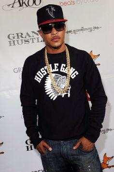 T.I. wearing a black and white Hustle Gang long sleeve shirt