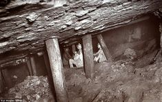 Cramped: Mines would often have to scrambled between the beams in claustrophobic condition...