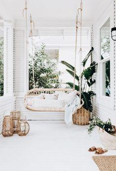 Trend // Cane lovebirds swing seat on a porch verandah