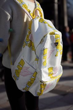 $17 - $279 We aren't the only ones who can't get enough of colorful prints. Check out this white and yellow backpack with Bart Simpson printing for a fun back to school outfit.