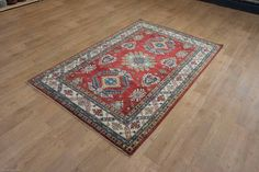 Hand Knotted Kazak Rug from Afghanistan. Length: 228.0cm by Width: 152.0cm. Only £1129 at https://www.olneyrugs.co.uk/shop/rugs-for-sale/afghan-kazak-21991.html    Take a look at our striking collection of Kazak rugs, carpets, kilim ottomans and Kilim bags at www.olneyrugs.co.uk