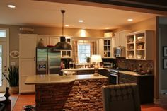 this woman did an amazing zero cost transformation on a cookie cutter house kitchen.  wow!