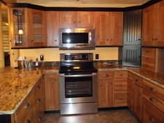 Hickory Cabinets With Black Painted Crown Molding And Light Rail, Granite  Counters By Swita Cabinetry