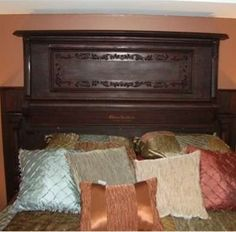 Piano Headboard  The stately polish of a piano is perfect for any formal setting, so why not repurpose an old piano into a headboard for a traditional-style bedroom? This one plays up the rich wood tones and intricate carvings of an antique upright and puts them to good, albeit nonmusical, use, ideal for a guest bedroom in a traditional or historic home.