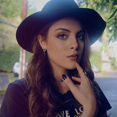 (Elizabeth Gillies) Hello, I'm Amber, and I'm a bit more of what you would call..alternative. I love listening to rock music, and I prefer darker clothing. However, I'm known for being rather creative, as I play the ukulele.