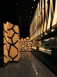 With its contrasting light oak and black polymer surfaces the shop resembles a high-end fashion boutique or bar much more than it does a bakery steeped in tradition or natural ingredients.