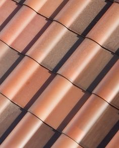 Tesla Solar Roof Terra Cotta Glass Tiles - I like black roofs but these are cool