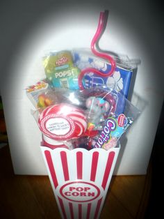 "Carnival Treat boxes.  Plastic popcorn boxes-2 for 99 cents at the dollar store.  Filled with Microwave popcorn (3 for one dollar @ Dollar store) Cotton candy flavored bubble gum, Charms cotton candy pops and gummy hotdogs, bubbles, twisty straw and an elephant sucker ring topped off with a pinwheel sucker with custom ""Thank you"" sticker (OrientalTrading Post) are ready for the May 19th Birthday Party."