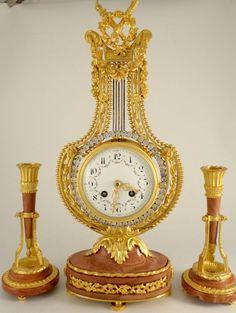 Antique French ormolu lyre clock garniture with swinging paste set pendulum | Ian Burton Antique Clocks