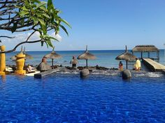 The beach and heated infinity pool at The Oberoi in Mauritius. The Oberoi, Mauritius, Swimming Pools, Paradise, The Incredibles, Patio, Island, Education, Country