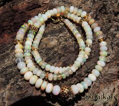 Exelent Ethiopian Red Opal Beads 18K Gold Bead by KalaKali on Etsy, €650.00