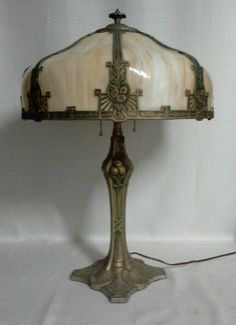 """c. 1910's, gilt and polychrome accented, white metal table lamp. Shade:17"""" diameter by 7-1/2"""" tall Lamp: 25-1/2"""" tall"""