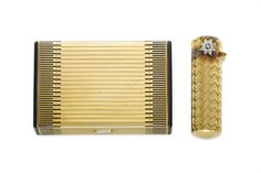 AN ART DECO ENAMEL AND GOLD CIGARETTE CASE AND A RETRO DIAMOND AND GOLD LIPSTICK HOLDER, BY CARTIER
