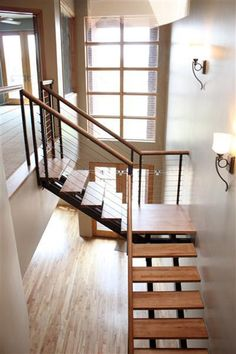 This kind of open stairway would work well if we reroute the stairs into the living room