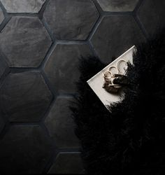 Eight-inch Hexagon tile installed as flooring, with dark charcoal grout - Cle Tile