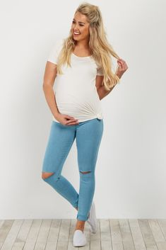 Solid convertible maternity skinny jean. Ripped knee detail. Elastic waistband. 5 pockets.