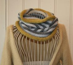 love how the simple stripes make chevrons in this cowl. . . . (not a good link, sorry)