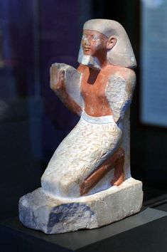 Limestone painted Statue of Sety, 18th Dynasty, early in the reign of Thutmose III. This statue of Sety, a scribe and superintendent of the treasury, is an early example of a non-royal person shown kneeling. The figure's pose, the obelisk-shaped back pillar ,(a solar symbol), and the inscribed prayer to the sun god Re indicate that the statue was set into a niche above Sety's tomb, facing east to greet the sunrise.
