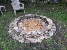 """Built this fire pit in just a few hours. It has an inner diameter of 48""""  Materials:  2 bags of Quickrete mortar, 2 bags of river rocks and Stones from around the yard     The only thing that's not really obvious from the picture is the 12"""" deep post hole*, filled with river rock in the middle to help water drain.   By post hole I mean that I used a hand post hole digger and dug down approx 12""""  If you can find stones around your yard this is cheap! They're not going to be uniform in size…"""