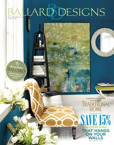 Love the large artwork and adore the navy paint color with gold accent  pieces.