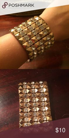 "Gold and ""diamond"" stud bracelet A heavy weight bracelet that brings a style and sass to a fun night out or outfit! All of the stones are in, just needs someone to wear it more than I do! Stretch fit no clasps. Jewelry Bracelets"