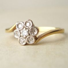 Vintage 18k Gold Diamond Daisy Flower Ring, Vintage Engagement Ring, Approx. Size US 6.5. $225.00, via Etsy.