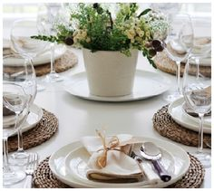 The woven wicker placemats help distinguish the glossy white plates from the matte white dining table. The two wine glasses are slightly different shaped. Dining Table Placemats, Dinner Party Table, Dinner Parties, Dinner Places, White Dining Table, White Plates, White Dishes, Dinner Sets, Homemade Home Decor