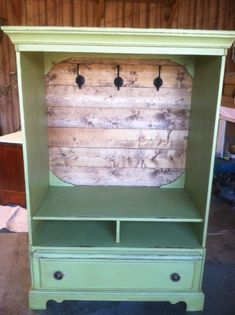 Great way to repurpose a old tv cabinet...cute for s little girl's room/costume wardrobe