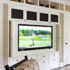 Lots of built in storage with folding doors to cover tv.