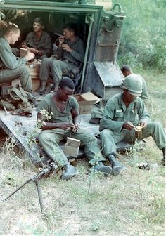 Soldiers of the 5th Mech. Inf., 25th Inf. Div. eat C-rations on the ramp of a M113 during Operation Cedar Falls, 1967.