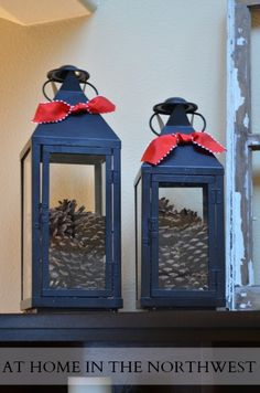 lanterns filled with pinecones  at home in the northwest