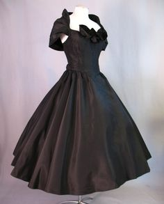 Vintage 50s Party Dress Black Taffeta Full Skirt  ■Skirt is gathered onto the waist and forms a full circle when laid flat.  ■Horsehair braid at the hem.     ■Dress closes with a center back metal zipper.  ■Bodice and upper skirt are lined in black cotton.
