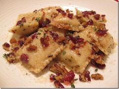Butternut Squash Ravioli's with a Browned Butter, Thyme, Cranberry & Pecan Sauce