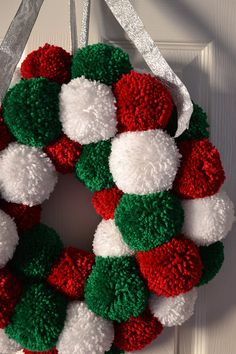 Christmas Pom Pom Wreath with red, green and white pom poms. In my last post I mentioned how much in love I am with my Clover pom pom maker and that I had an idea for a wreath. Well, it's finished now . Cone Christmas Trees, Christmas Makes, Christmas Wreaths, Christmas Ornaments, Green Christmas, Christmas Smells, Crochet Christmas Wreath, Christmas Christmas, Pom Pom Wreath