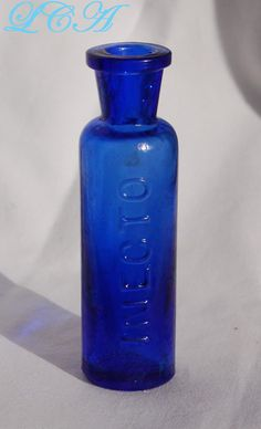 Your place to buy and sell all things handmade Antique Glass Bottles, Weird Shapes, Antique Clocks, Insect Repellent, Bottles And Jars, Cobalt Blue, Color Blue, Vases, Bowls