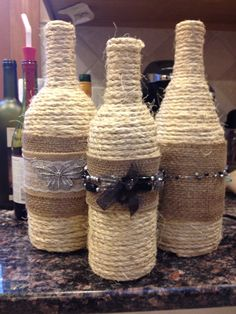 Wine bottles crafted with twine and jewelry