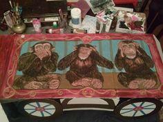 three monkeys in a circus train car. Speak no evil, see no evil, hear no evil.